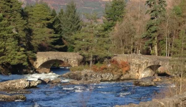 multi-arched stone bridge by Falls of Dochart