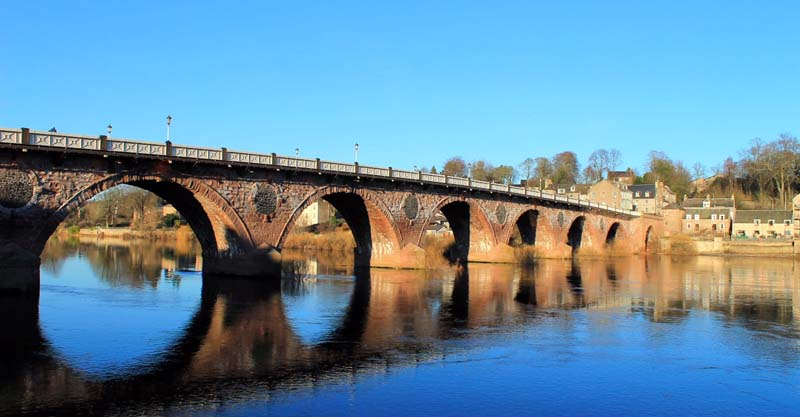 Perth old bridge from the bank of the river Tay
